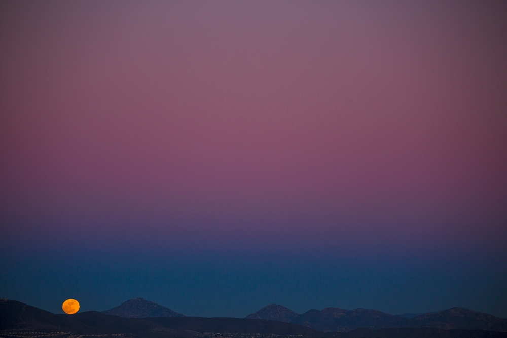 Mountain moonrise from Del Mar's Torrey Pines ridge