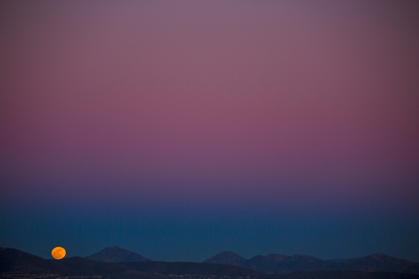 Mountain moonrise from Del Mar's Torrey Pines ridge