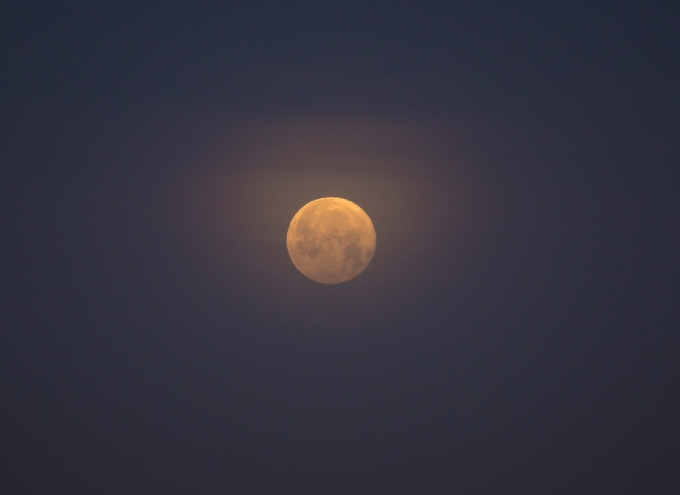 The moon in a cirrus gauze