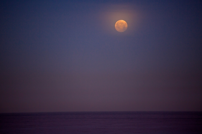 The moon and thin cirrus over the Pacific